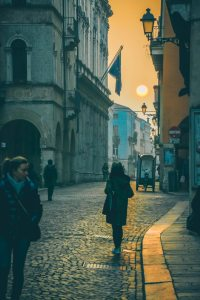 photo-of-people-walking-on-cobblestone-street-910392